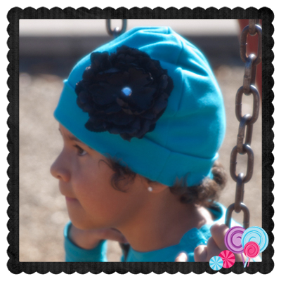Turquoise Hat Black Flower